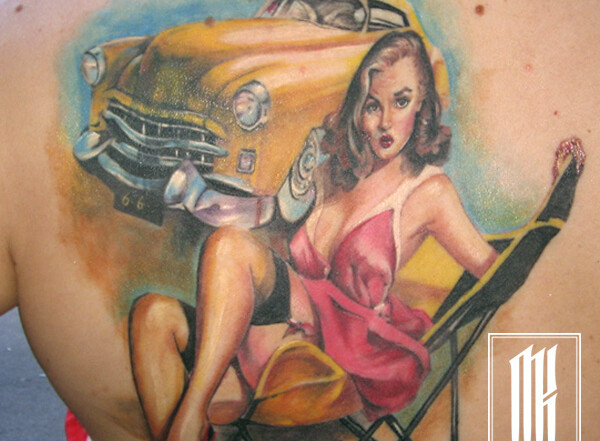 татуировка для девушки на лопатке